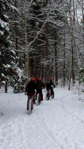Father and Sons heading out for a Snowbike ride.